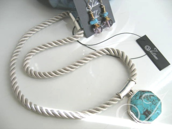 With silky soft silver satin braided cord and this stunning turquoise